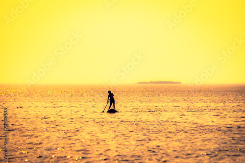 Foto Spatwand Strand Stand Up Paddle Boarder at sea. Photo from Oulu, Finland.