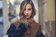 Leinwanddruck Bild - Beautiful blonde russian woman in urban background
