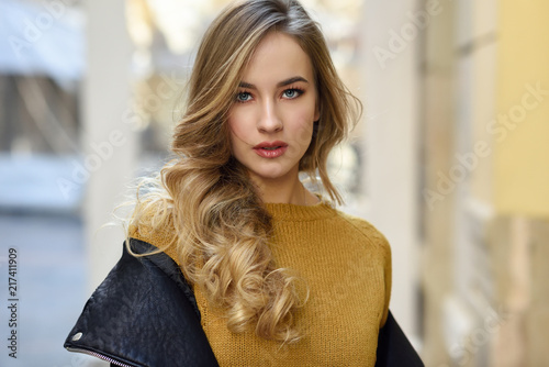 Leinwanddruck Bild Beautiful blonde russian woman in urban background