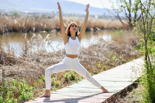 Obraz na płótnie Young woman doing yoga in the beach