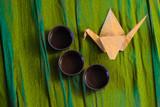 Three cups of ceramics and a origame  crane