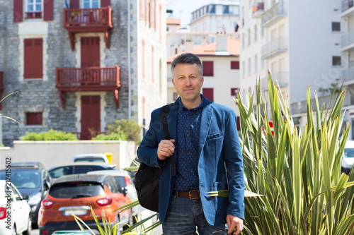 Foto Murales Handsome man. Outdoor male portrait. Middle-aged man, street photo, Biarritz, France.