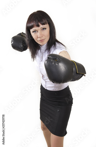 Business woman in boxing gloves
