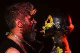 Halloween man with devil horns and woman with skull face - 217435577