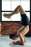 yoga for men. sport fitness and athletic lifestyle. strong body and toned muscles. man exercising asana in gym. - 217460534