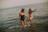 Pretty young women having fun by the sea