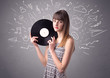 Quadro Young lady holding vinyl record on a grey background with mixed scribbles behind her