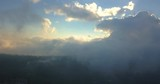 Aerial footage still  over the calm skies at sunset time - 217475949