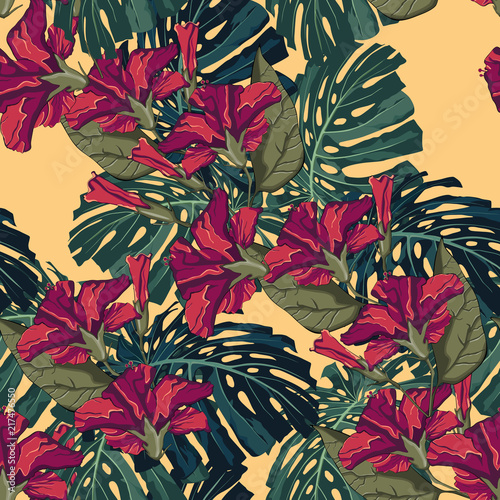 Tropical red hibiscus flowers and monster leaves seamless pattern. Palm tree leaves decoration on yellow background. Colorful exotic rainforest wallpaper. - 217476550