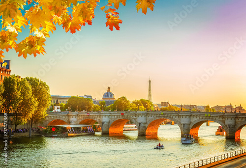 bridge Pont Neuf and Seine river at sunny autumn sunset, Paris, France, toned