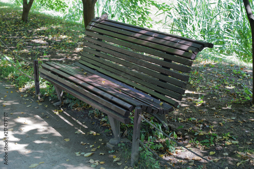 Old Fashioned Wooden Bench For Rest In Summer City Park