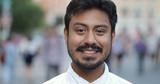 Hispanic man in city smile happy face portrait - 217499117