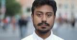Hispanic man in city face portrait - 217499119