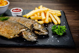 Fish dish - roast trout with vegetables - 217517109