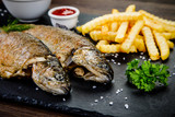 Fish dish - roast trout with vegetables - 217517124