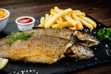 Fish dish - roast trout with vegetables - 217517136