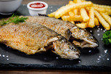 Fish dish - roast trout with vegetables - 217517149