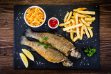 Fish dish - roast trout with vegetables - 217517175