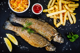 Fish dish - roast trout with vegetables - 217517196