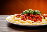 Penne with meat, tomato sauce and vegetables - 217518734