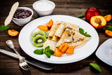 Crepes with fruits and creme  - 217518778