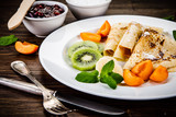 Crepes with fruits and creme  - 217518789