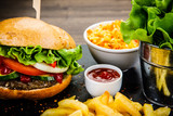 Tasty burger with chips served on stone plate  - 217519111
