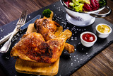 Roast chicken legs with and vegetables - 217519160