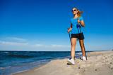Nordic walking - young woman training - 217520111