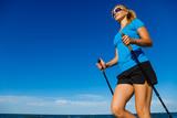 Nordic walking - young woman training - 217520121