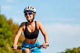 Young woman biking - 217520139