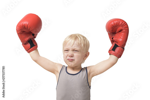Funny blond boy in red boxing gloves. Sports concept. Isolate