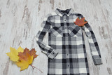 Checkered shirt and maple leaves. Fashionable concept - 217537975