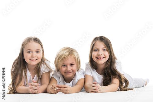 Foto Murales Happy children isolated on white