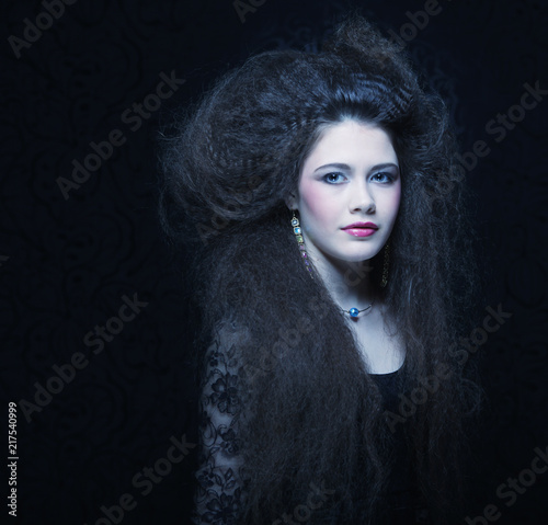 Foto Murales Beautiful young woman with curly hair and evening make-up. Jewelry and Beauty concept. Fashion art photo.