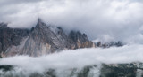 Mountain panorama in the Dolomite Alps, Italy. Mountain ridge in the clouds. Beautiful landscape at the summer time