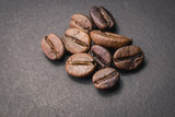Close up of coffee beans are the background.