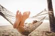 Leinwanddruck Bild - Happy woman relaxing in hammock