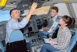 Students with instructor in aircraft cockpit