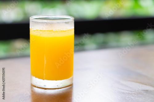 Aluminium Sap Closeup orange juice on wood table, drink for healthy concept, selective focus