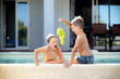 children eat fruit on holiday at the pool