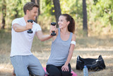 couple and dumbbells
