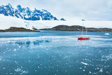 sailing boat in Antarctica, travel by yacht cruise, beautiful remote tourism destination - 217568779