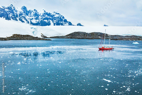 sailing boat in Antarctica, travel by yacht cruise, beautiful remote tourism destination