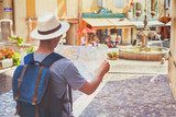 traveling people, tourist looking at map on the street in France, Europe - 217568954