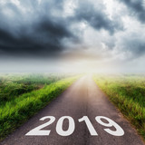Empty asphalt road and New year 2019 concept. Driving on an empty road to Goals 2019. - 217569525