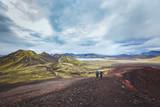 hiking in Iceland near Landmannalaugar, couple of backpackers walking in beautiful moon landscape, travel - 217569557