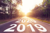 Empty asphalt road and New year 2019 concept. Driving on an empty road to Goals 2019. - 217569914