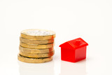 Housing estate concept with coins in studio - 217573108