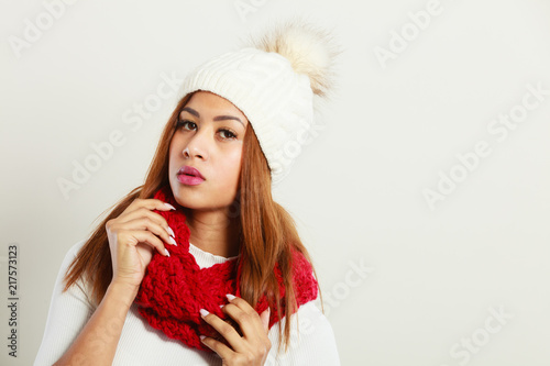Foto Murales Mulatto woman wearing warm winter clothing